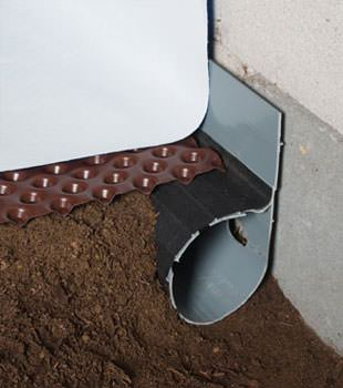 Closeup of a crawl space drainage system installed in Elmira