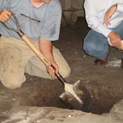 Digging a hole for the engineered fill used in a crawl space support system installation in Cambridge