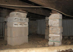 crawl space repairs done with concrete cinder blocks and wood shims in a Ancaster home