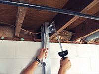 Straightening a foundation wall with the PowerBrace™ i-beam system in a Milton home.