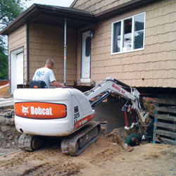 Excavating to expose the foundation walls and footings for a replacement job in Waterloo