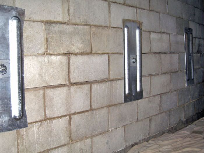 An Inside View Of Foundation Wall Anchors Installed Along A Basement To Brace And Repair