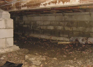 Rotting, decaying crawl space wood damaged over time in Fergus