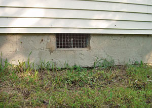 Open crawl space vents that let rodents, termites, and other pests in a home in Welland