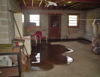 a flooded basement floor in a Acton home