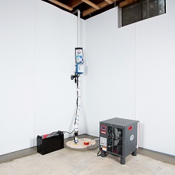 Sump pump system, dehumidifier, and basement wall panels installed during a sump pump installation in Georgetown