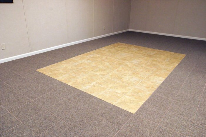 tiled and carpeted basement flooring installed in a Kitchener home
